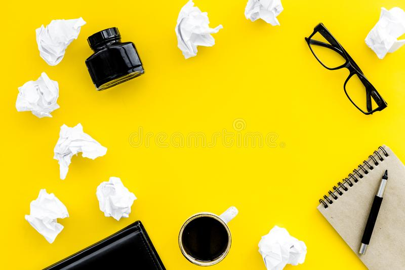 Writer workplace with tools for work on yellow table background top view mockup. Writer workplace with tools for work on yellow office table background top view stock photo