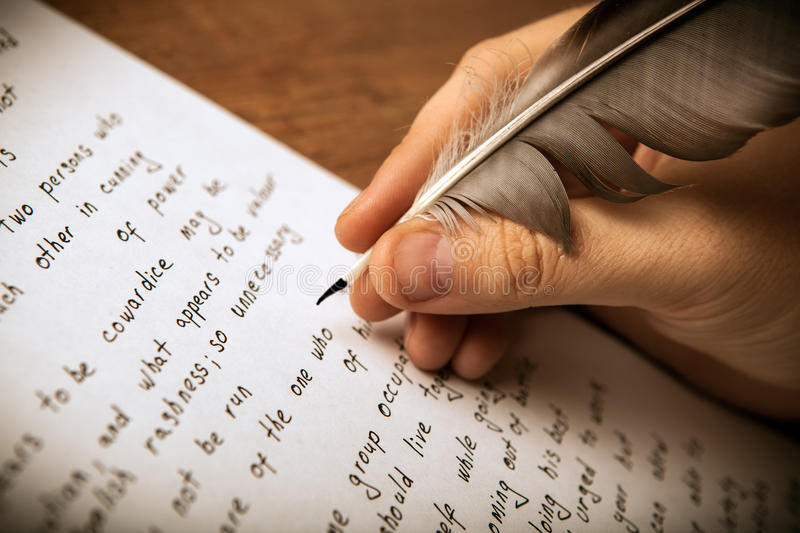 Writer writes a fountain pen on paper work. Close up stock photo