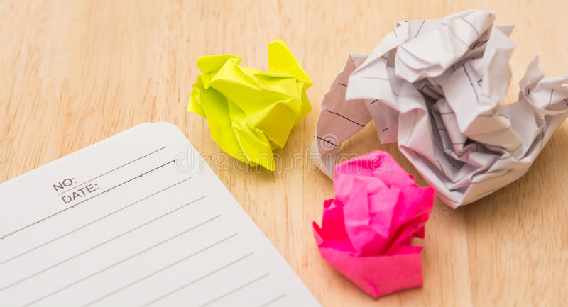 Writers Block. Paper lump. on wooden background stock images