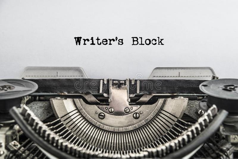 Writers Block typed text on a Vintage Typewriter. Old paper, close-up. The writer`s tool stock images