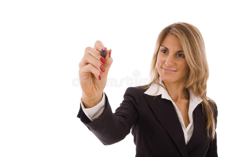Writing. Business women writing something with a pink marker royalty free stock image