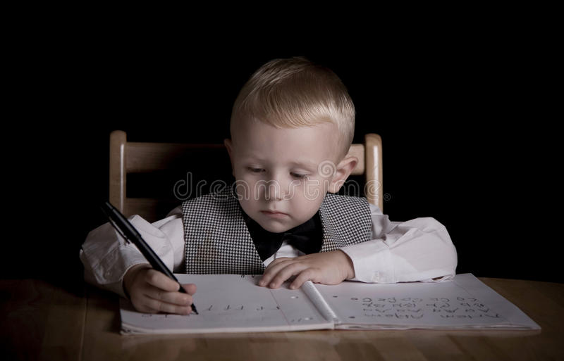 Writing. Image of the boy learning to write