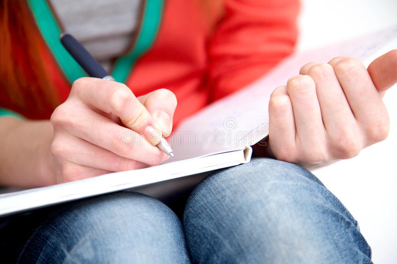 Writing. Clouse-up of female hands writing in notebook stock images