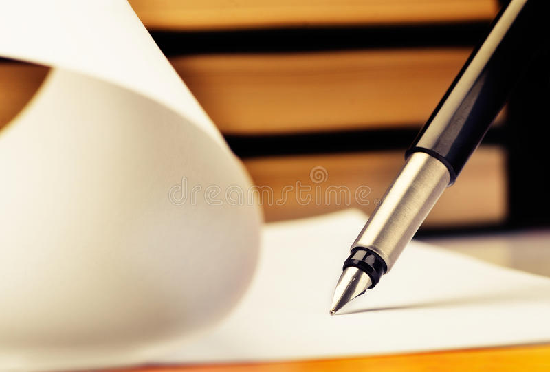 Writing. Close-up of fountain pen and book royalty free stock images