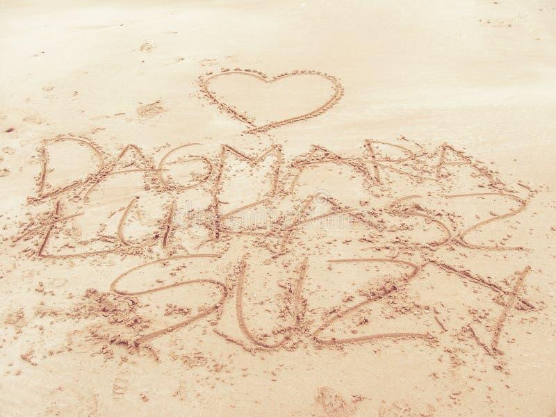 Writing on a beach - love letters on sand stock photos