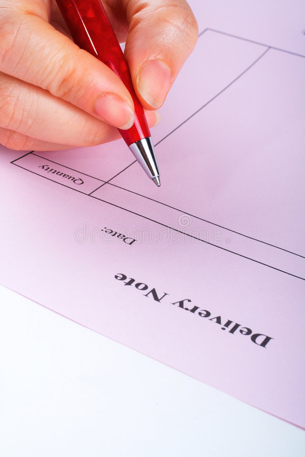 Writing blank delivery note with pen stock photos