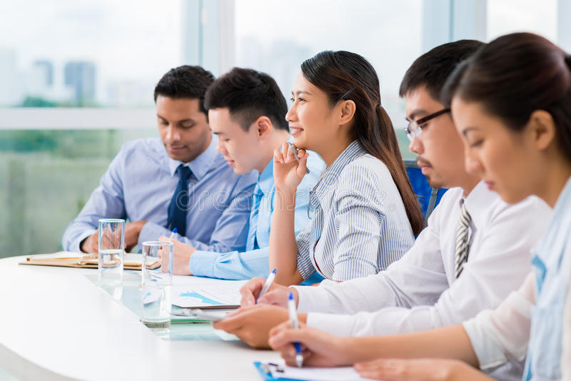 Writing. Business people writing during business training stock photo