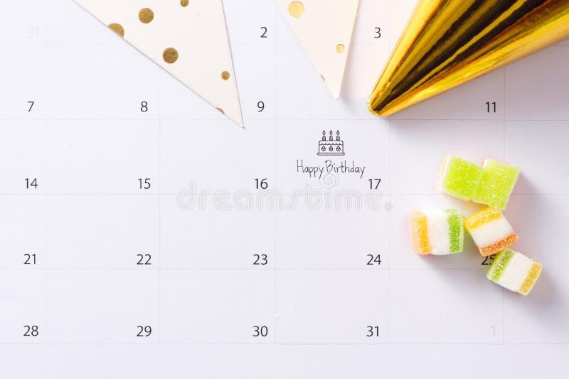 Writing cake on calendar happy birthday royalty free stock images