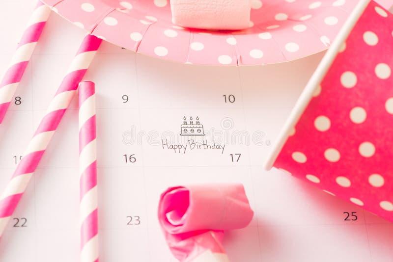 Writing cake on calendar happy birthday stock photos