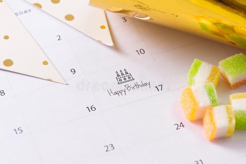 Writing cake on calendar happy birthday royalty free stock photography