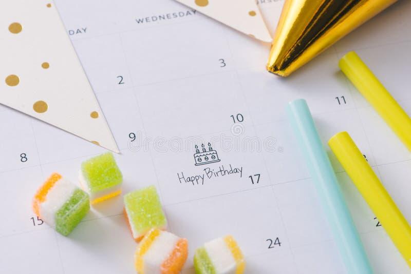 Writing cake on calendar happy birthday stock photo