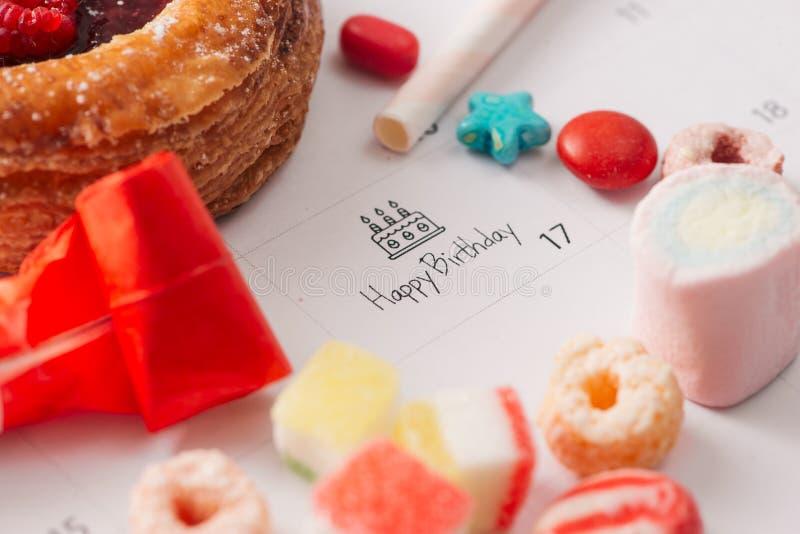 Writing cake on calendar happy birthday royalty free stock photo