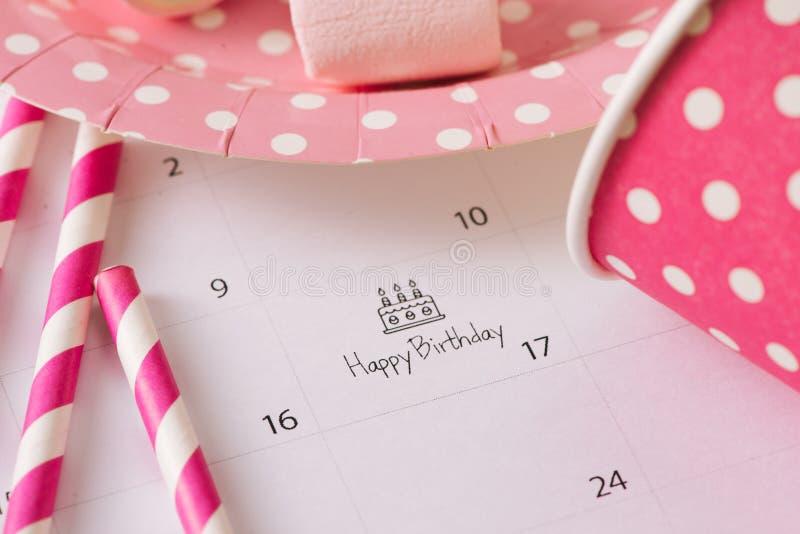 writing cake on calendar happy birthday. royalty free stock photography