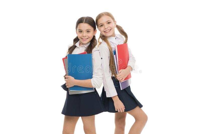 Writing by calligraphic hand. Adorable little children learn reading and writing at school. Cute small schoolgirls stock photos