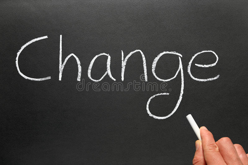 Writing change on a blackboard. royalty free stock photography