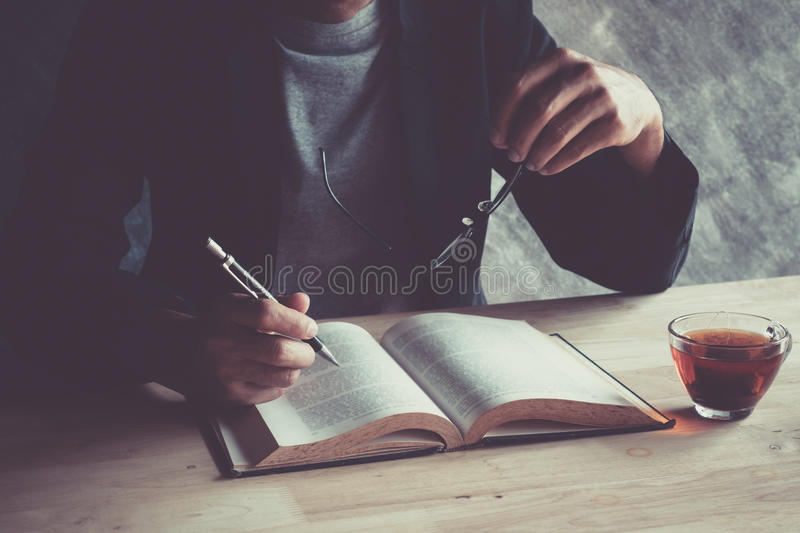 Writing a check hot tea on a wooden table. royalty free stock photos