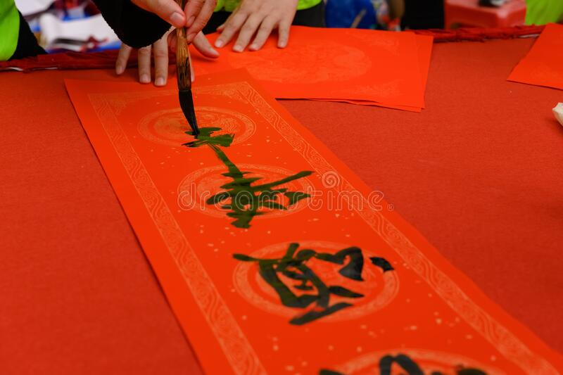 Writing Chinese new year scrolls the Chinese means happy new year royalty free stock image