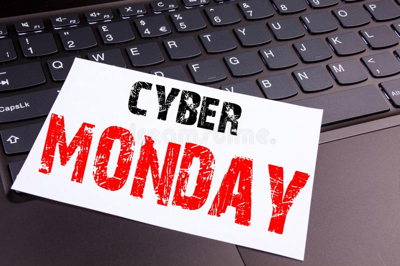 Writing Cyber Monday text made in the office close-up on laptop computer keyboard. Business concept for Retail Shop Discount Works. Hop on the black background stock photography