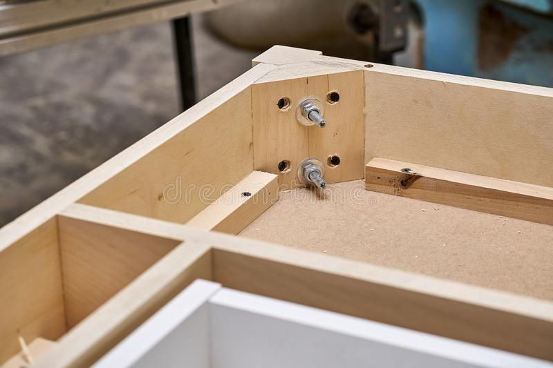 Writing desk building process. Production of wood furniture. Furniture manufacture. Close-up. Beautiful professionally made wood writing desk in process of royalty free stock photography