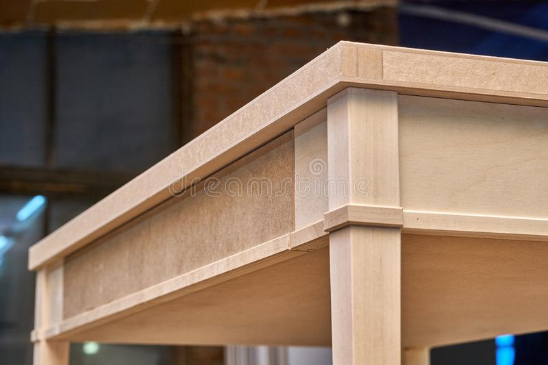 Writing desk building process. Production of wood furniture. Furniture manufacture. Close-up. Beautiful professionally made wood writing desk in process of stock photography