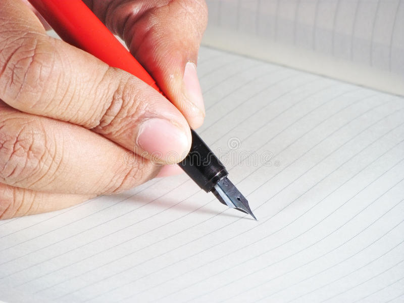 Diary writing. Writing a diary with a classical fountain pen. The close up shot leaves some white space on the diary page where you could put your own text stock photography