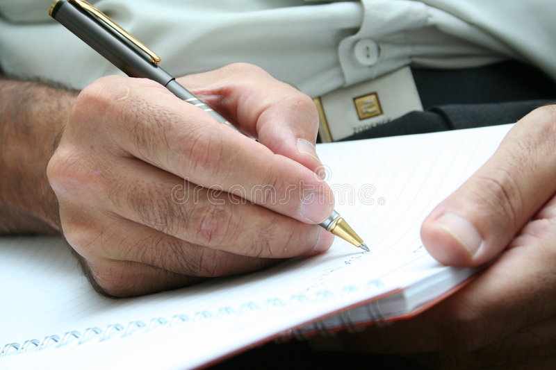 WRITING IT DOWN. Writing a contract stock photos