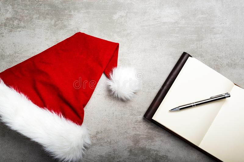 Writing down christmas wishes stock photography