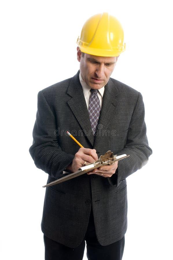 writing för estimate för arkitektbyggmästareleverantör fotografering för bildbyråer