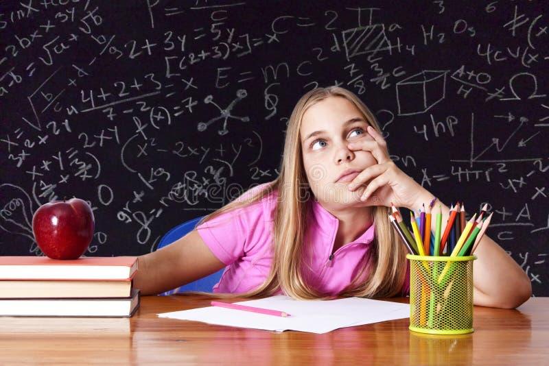 writing för flickaskolatabell arkivfoto