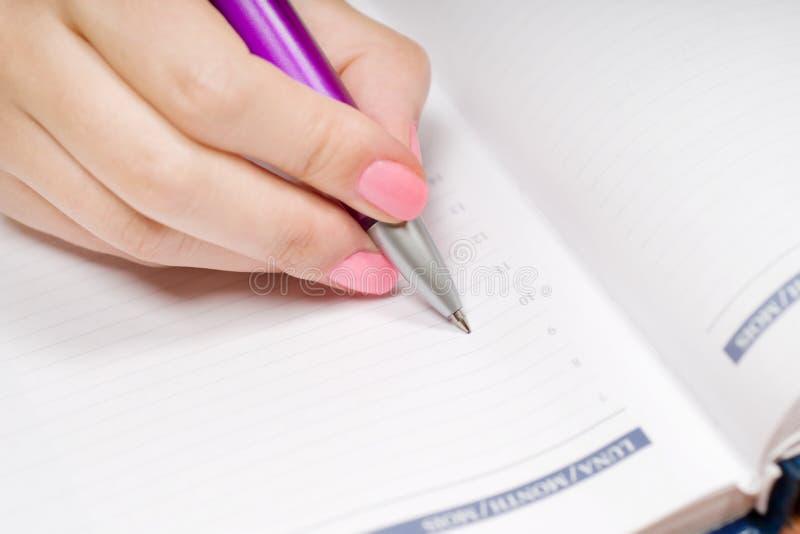 writing för handanteckningsbokpenna royaltyfri foto