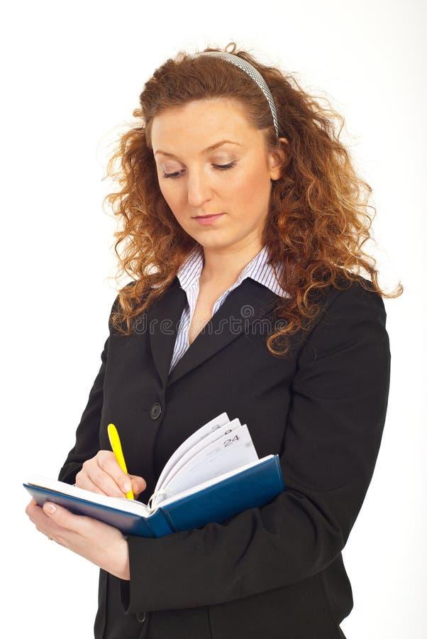 writing för kvinna för dagordningaffärsredhead royaltyfri foto