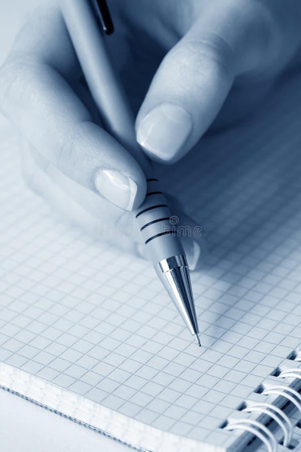 writing för kvinnlighandsida fotografering för bildbyråer