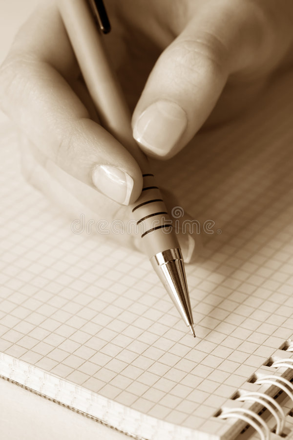 writing för kvinnlighandsida royaltyfri bild