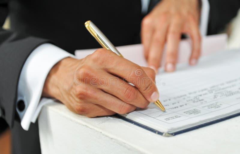 writing för penna för handmananteckningsbok royaltyfria foton