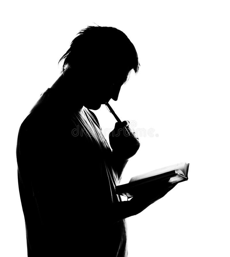 writing för silhouette för affärsdagbokman arkivbild