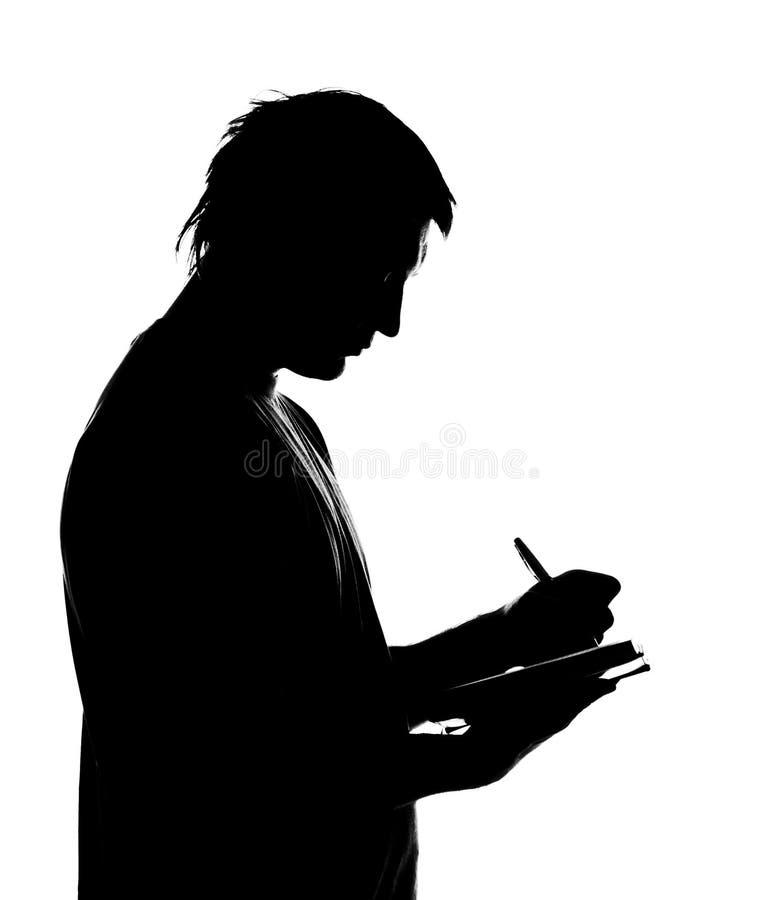 writing för silhouette för affärsdagbokman arkivfoton