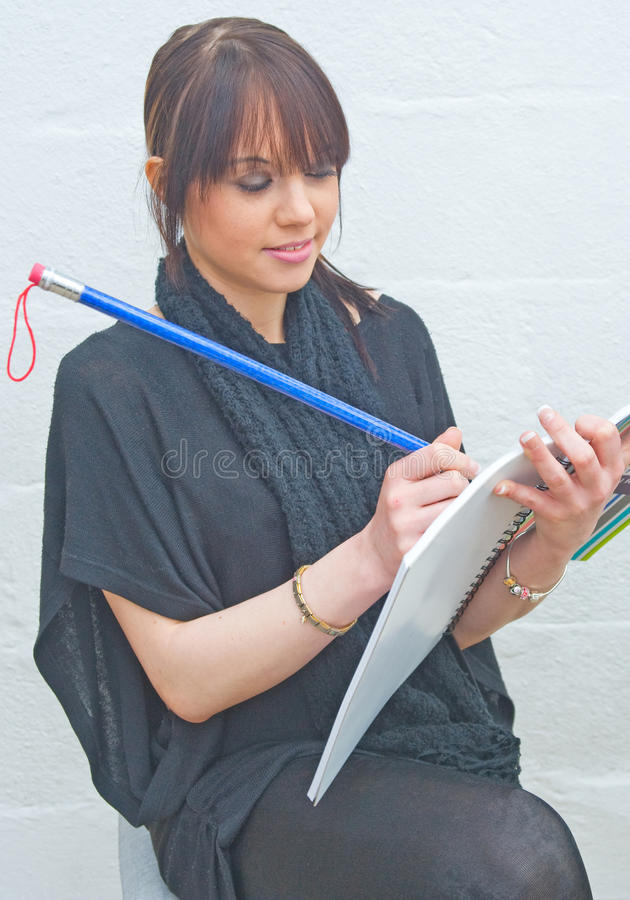 Writing with a giant pencil ! stock photos