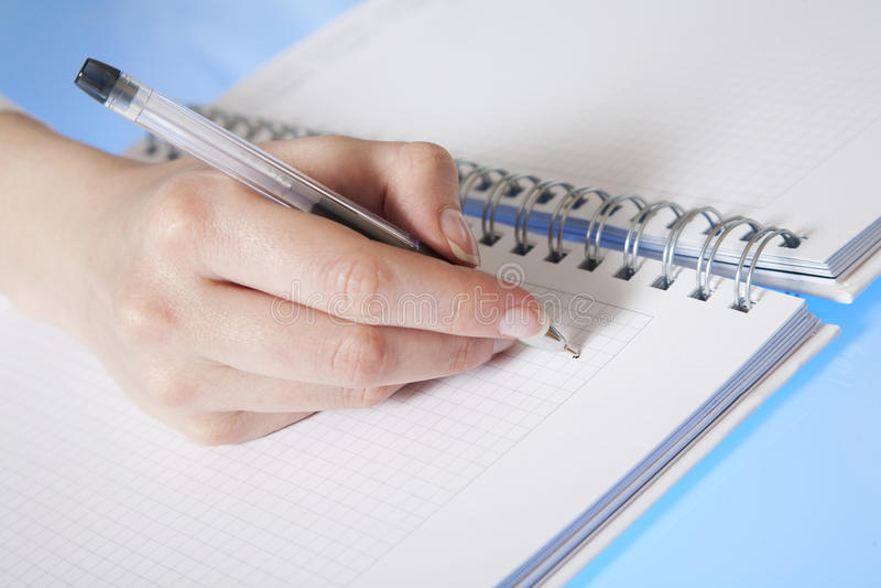 Writing hand stock image