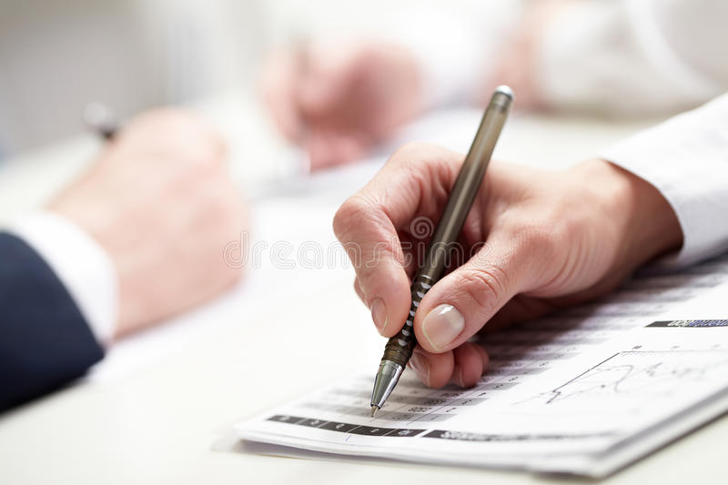 Writing hand stock photography