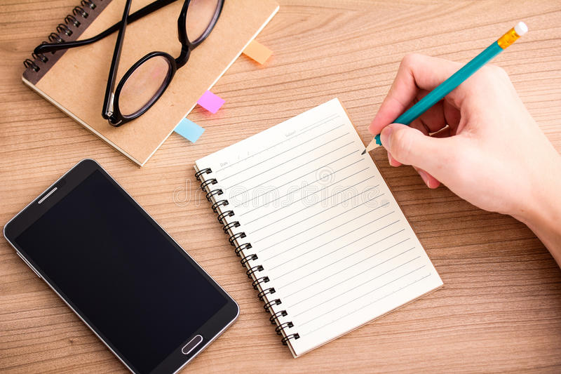 Writing a journal royalty free stock image