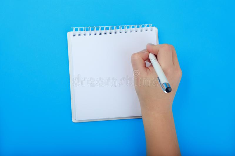 Writing a letter or making a list in blank Notepad royalty free stock photography
