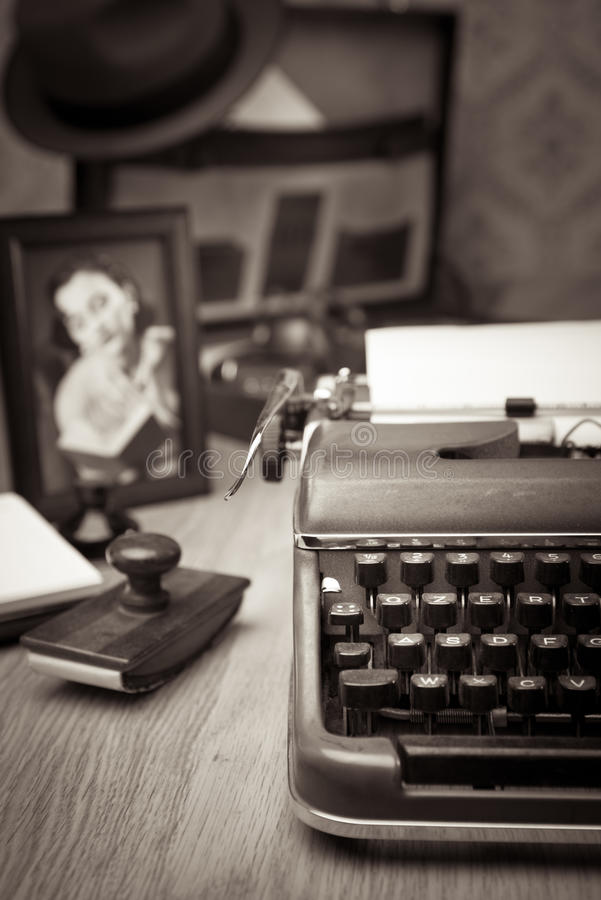 Writing a letter on vintage typewriter stock photo