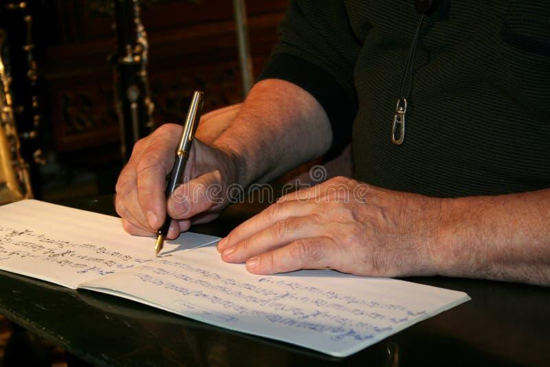 Writing musical notes royalty free stock photo