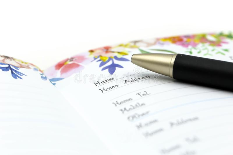 Writing the name on a paper with a pen using for concept of Namesake day.  stock photo