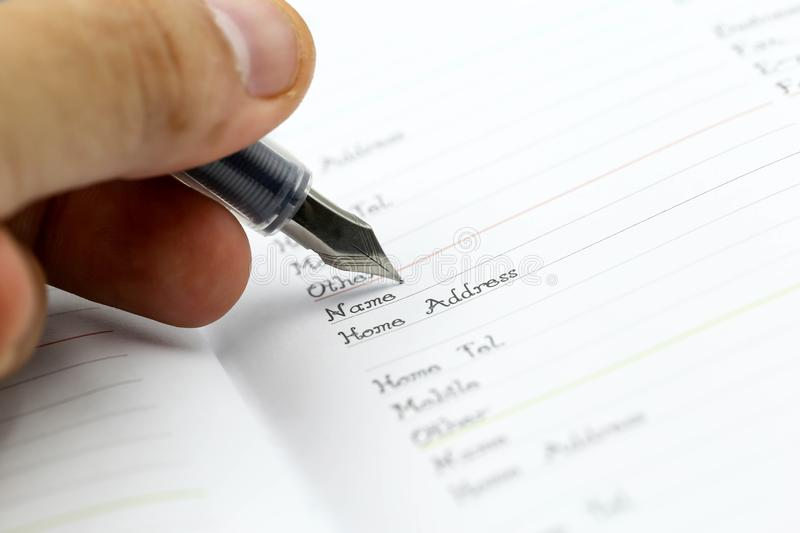 Writing the name on a paper with a pen using for concept of Namesake day.  royalty free stock photography