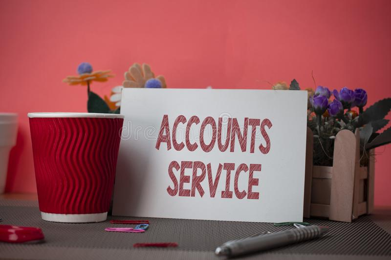 Writing note showing Accounts Service. Business photo showcasing accessing list of user profiles and information linked. Writing note showing Accounts Service stock photo