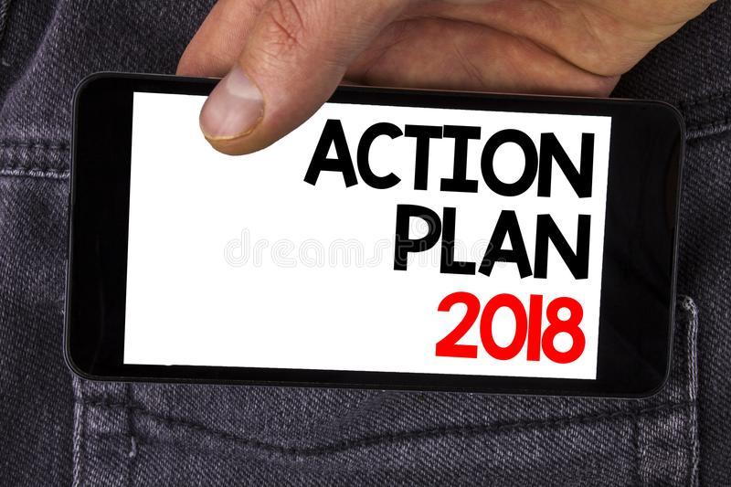 Writing note showing Action Plan 2018. Business photo showcasing to do list in new year New year resolution goals Targets written. Mobile Phone Screen holding royalty free stock photography