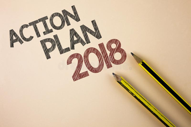 Writing note showing Action Plan 2018. Business photo showcasing to do list in new year New year resolution goals Targets written. Plain background Pencils next royalty free stock photos