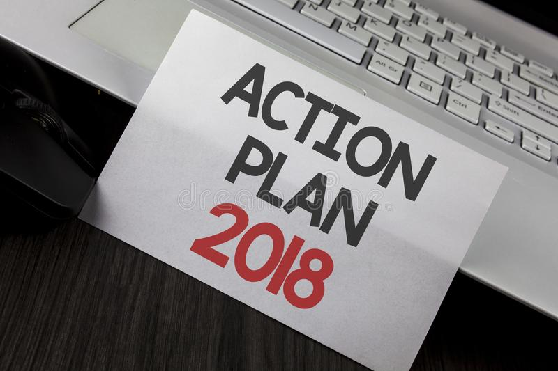 Writing note showing Action Plan 2018. Business photo showcasing to do list in new year New year resolution goals Targets written. White Sticky Note Paper stock image