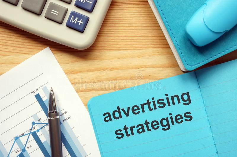 Writing note showing advertising strategies. Business photo showcasing advertising strategies. The text is written in the blue stock photo